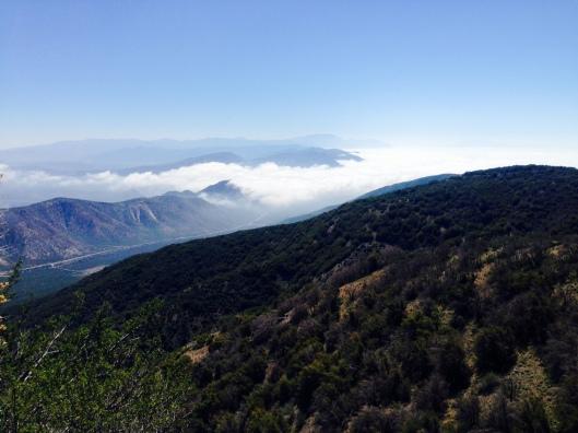 Clouds rolling in on Cajon Pass down below.