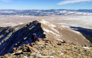 Jenny works her way up the rocks on the increasingly narrow ridge.